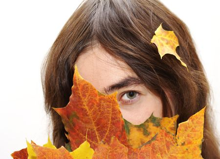 behind scenes: Young lady hiding autumn maple leafs    Stock Photo