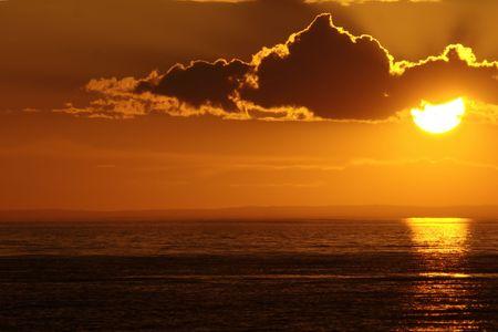 Warm weather sunset with cloud. Baikal lake, Russia. photo