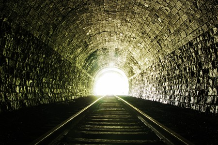 Light at the end of railroad tunnel. Natural lighting. Stock Photo - 7451862