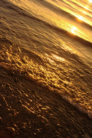 Baikal water under gold-colored sunset lighting photo