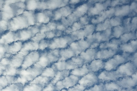 polarization: Cloudscape with altocumulus clouds . The photograph made with polarization filter.