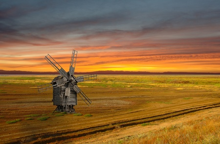 peasantry: Sunset landscape with medieval windmill in steppe