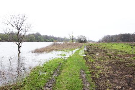 oka: The rural road flooded by Oka river  Stock Photo