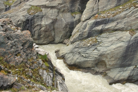 riffle: Water stream in the rift near the Grossglockner mountain, Alps, Austria