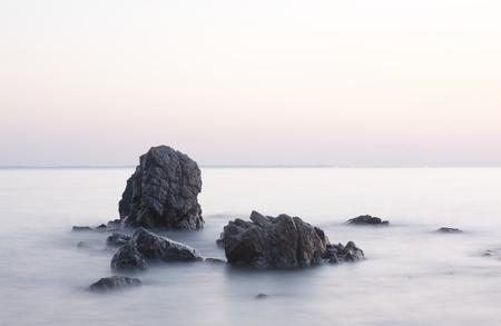 aegean sea: Long exposure image of stones in sea water, Greece, Aegean sea,