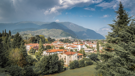 Cityscape of Bassano del Grappa with mediteran style houses and hills in the background Alpini in Vicenza, Italy Stock Photo