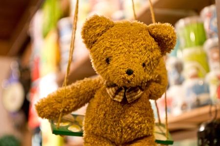 Brown Shy Teddy Bear on swing Stock Photo - 11985865