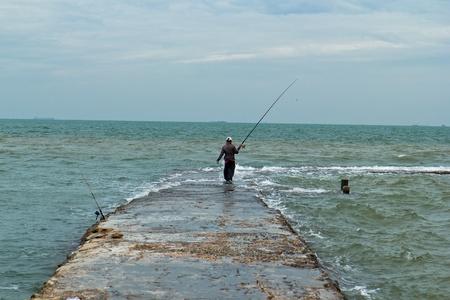 Man fishing at Pattaya sea photo