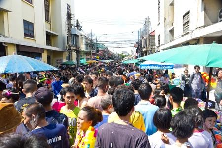 KHAO SAN ROAD, BANGKOK - 2012 APRIL 13: Crowd at entrance of Khao San Road 2