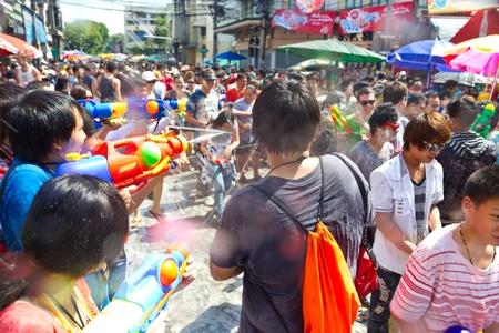 watergun: KHAO SAN ROAD, BANGKOK - 2012 APRIL 13: People shooting their watergun Editorial