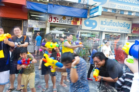 KHAO SAN ROAD, BANGKOK - 2012 APRIL 13: Battle of watergun around Khao San Road