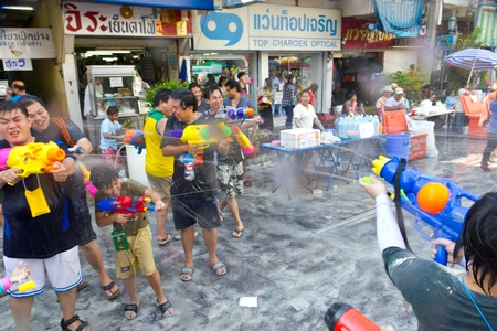 KHAO SAN ROAD, BANGKOK - 2012 APRIL 13: Battle of watergun around Khao San Road 2