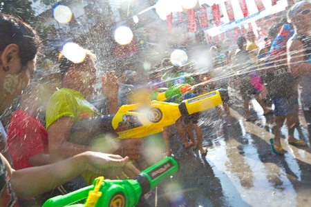 KHAO SAN ROAD, BANGKOK - 2012 APRIL 13: Shooting water gun