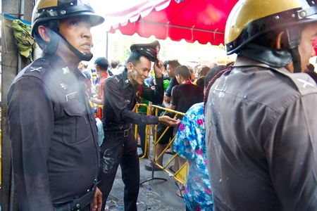 KHAO SAN ROAD, BANGKOK - 2012 APRIL 13: Police playing Songkarn