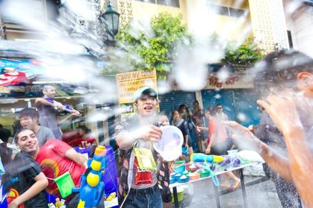 KHAO SAN ROAD, BANGKOK - 2012 APRIL 13: throwing water