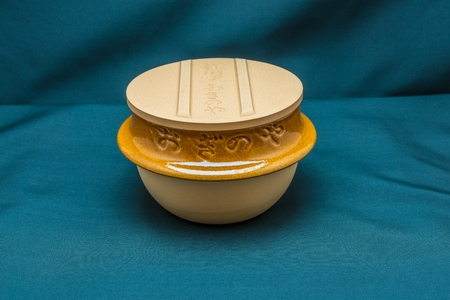 Japanese clay bowl with cover in front view