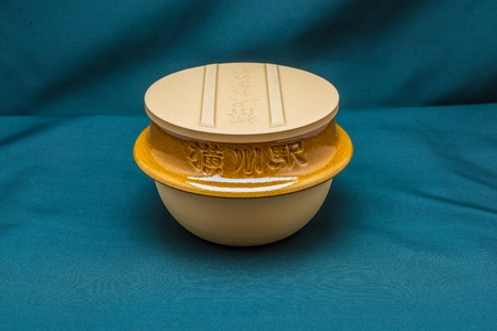Japanese clay bowl with cover in back view Stock Photo