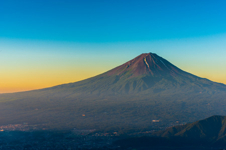 Top of Fujisan which is red in early morning from Shindotoge near Kawaguchi lake