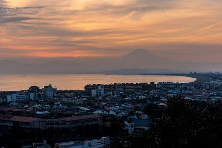 Sunset view of Tsujido beach with hiding Mt. Fuji in Kanazawa prefecture Stock Photo