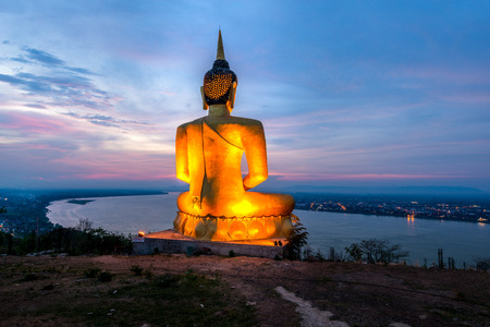 A giant Buddha image statue looking to Mekong river