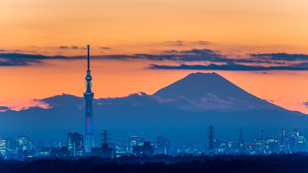 light to dark: CHIBA, Japan - DEC 18, 2015: Battle of light and darkness light-up of Tokyo Skytree with Mt. Fuji