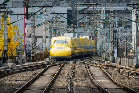 TOKYO, Japan - DEC 6, 2015: Doctor Yellow, a special Shinkansen, is approaching to Tokyo station.