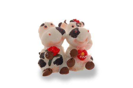 Mucca giocattolo e Toro isolato su un bianco