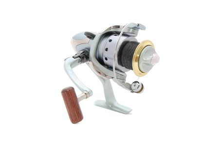 spinning reel: spinning reel isolated on a white