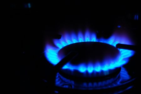 Blue flames of gas stove Stock Photo