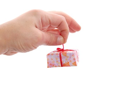 Man's hand with a little gift isolated on a white Stock Photo - 3989958