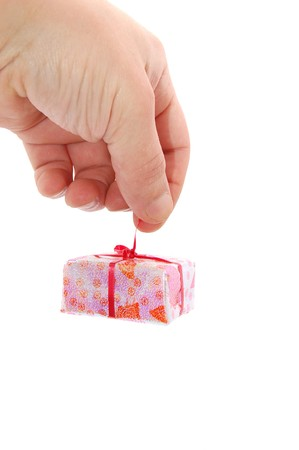 Man's hand with a little gift isolated on a white Stock Photo - 3989963