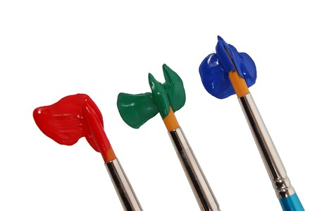three brushes painting colors Stock Photo