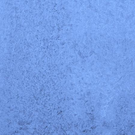 Frosty pattern at a window glass, toned to blue