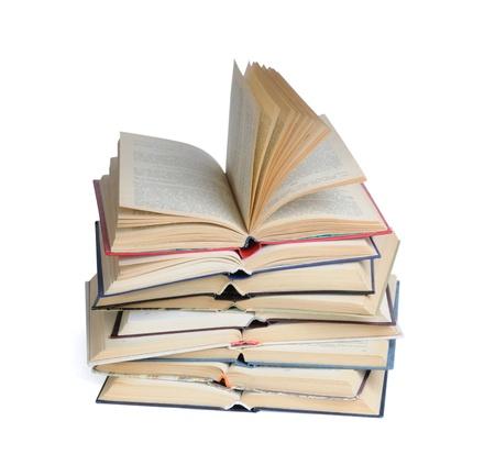 Pila di libri aperti isolato su uno sfondo bianco Archivio Fotografico
