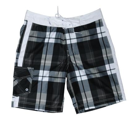 shorts: Pantalones cortos de tablero de ajedrez aisladas sobre un fondo blanco Foto de archivo
