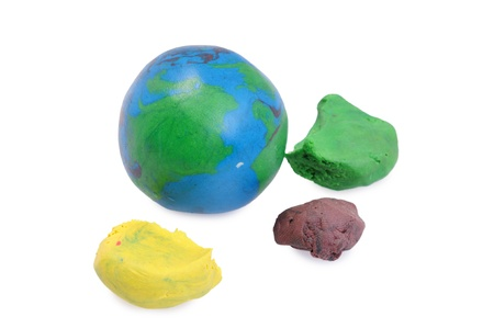 Plasticine globe and pieces of plasticine isolated on white Stock Photo - 12968204