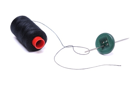 Spool of thread and needle isolated on white Stock Photo - 13051989