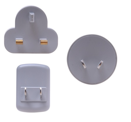 Electrical plug adapters isolated on a white background photo