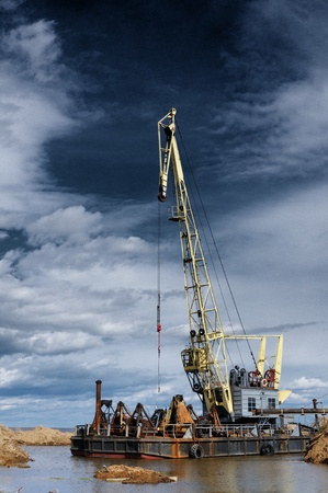 The port crane against the blue cloudy sky Stock Photo - 13453486