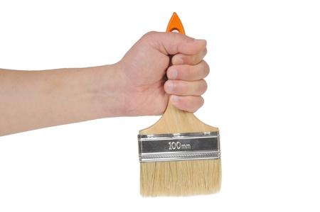 hand and paintbrush isolated on white background Stock Photo