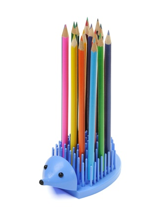 Hedgehog - a support for pencils isolated on a white background photo