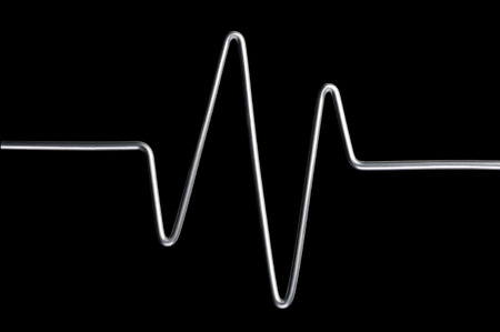 oscillations: Aluminum wire sinusoid isolated on a black background