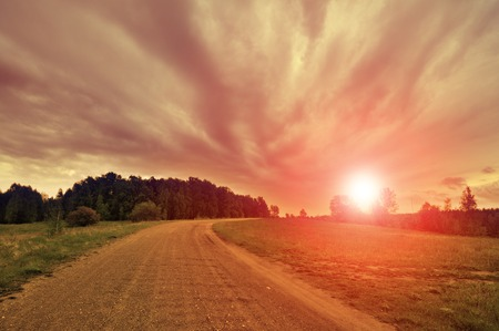 rise fall: Turning the gravel road and sunset