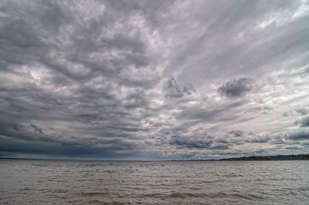 Dark cloudy sky on the Volga River