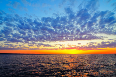 Sunrise with bright clouds on the Volga River Stock Photo