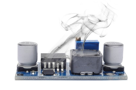 stabilizer: The electronic voltage stabilizer smokes from overheating. Isolated on white.