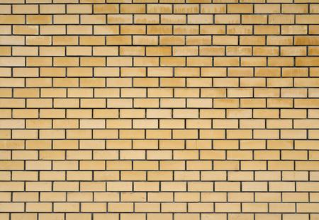 Texture of the yellow brickwork.