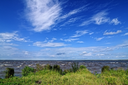 Beautiful water landscape with cloudy blue sky.