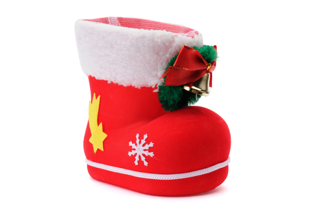 Red Santas shoe stuffed with Christmas presents over white background