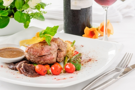 Beefsteak dishes  Decoration on a white plate  photo